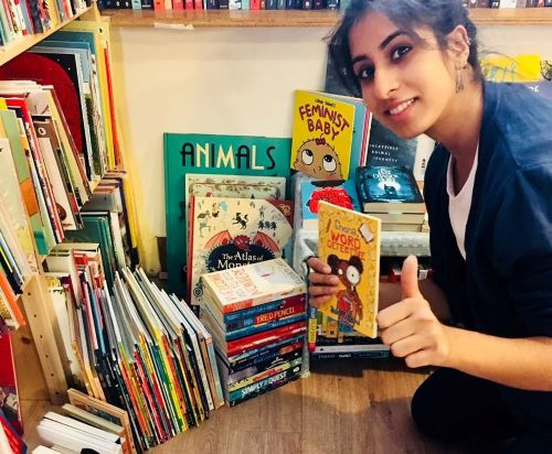 Noor with board books